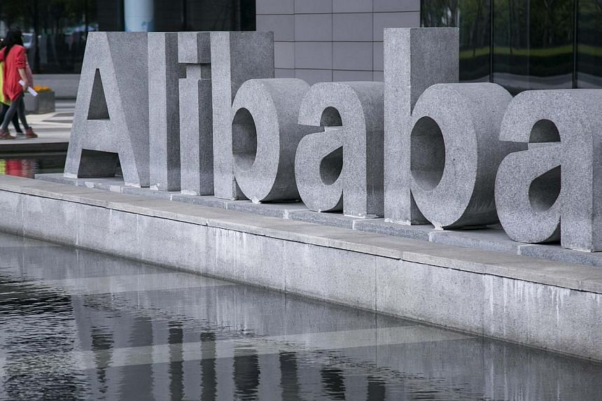 People walk at the headquarters of Alibaba in Hangzhou, Zhejiang province on April 23, 2014. -- PHOTO: REUTERS
