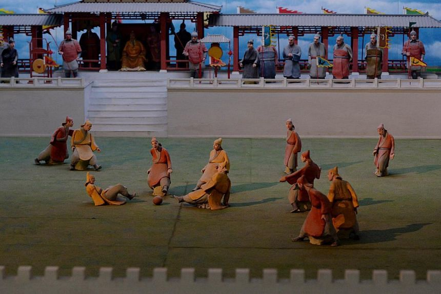 A miniture model illustrating a traditional Chinese Cuju football game at the Linzi Football Museum in Zibo, Shandong Province on May 15, 2014. -- PHOTO: AFP