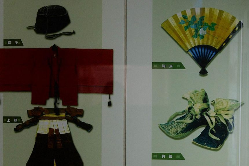 Clothing worn by players of traditional Chinese Cuju football at the Linzi Football Museum in Zibo, Shandong Province on May 15, 2014. -- PHOTO: AFP