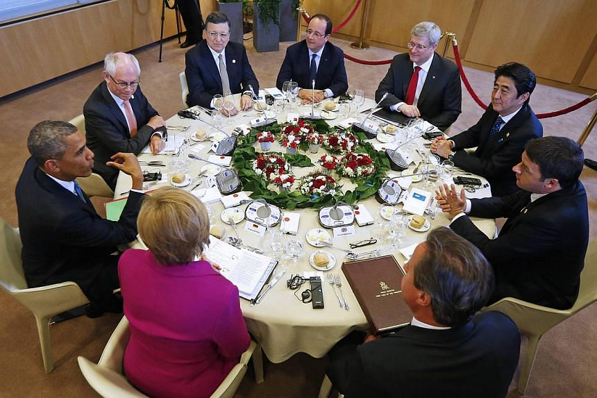 (From leftmost person clockwise) US President Barack Obama, European Council President Herman Van Rompuy, European Commission President Jose Manuel Barroso, France's President Francois Hollande, Canada's Prime Minister Stephen Harper, Japan's Prime M