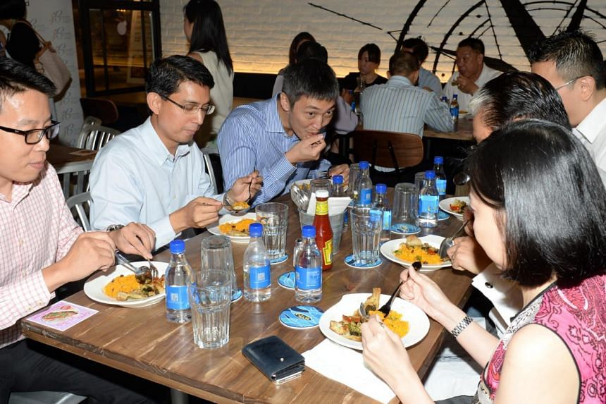 HPB on Wednesday launched its healthier food strategy, which sees it partner 18 food service providers to serve 500-calorie meals across 700 outlets and stalls islandwide. -- ST PHOTO: AZIZ HUSSIN