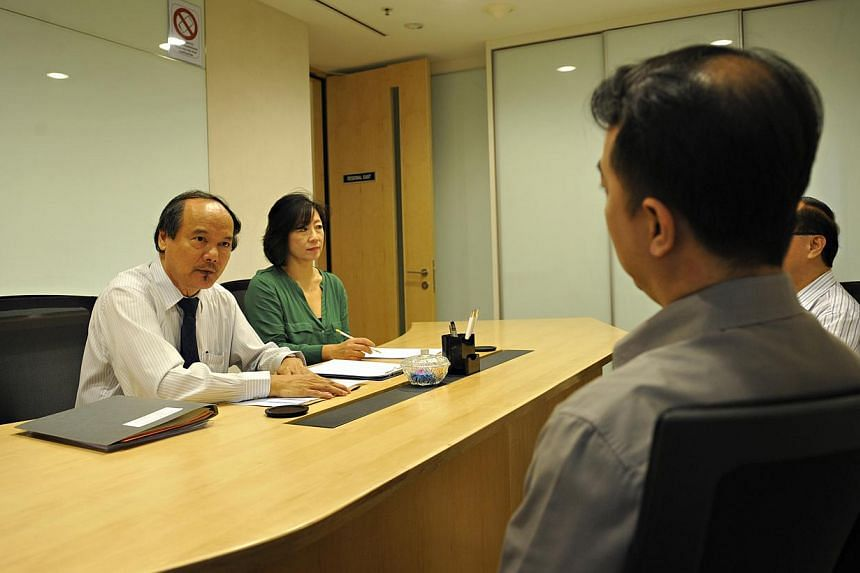 Dr Lim Lan Yuan (left) and Madam June Wong conducting a mock mediation session. -- PHOTO: ST FILE