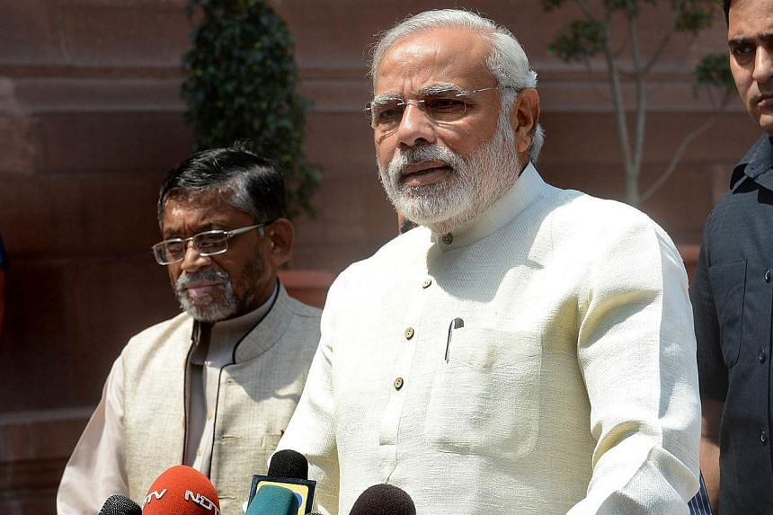 Mr Modi, who swept to power in a general election last month, has accepted an invitation from Mr Obama for two-way talks in Washington, the Times of India and the Hindustan Times said. -- PHOTO: AFP