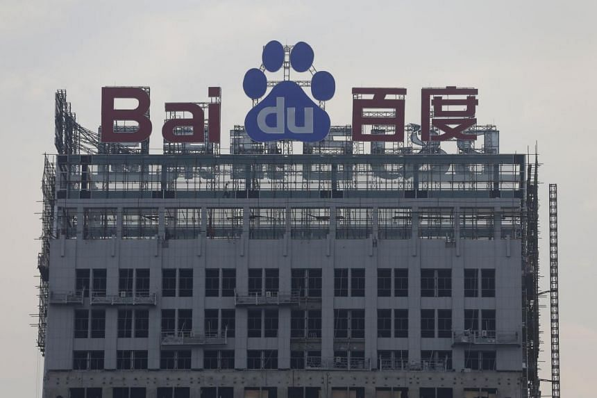 A logo of Baidu is seen at the top of a building under construction in Wuhan, Hubei province, on Aug 31, 2012.Chinese censors are investigating 52 websites owned by companies including top search engine Baidu and online video business Youku Tud