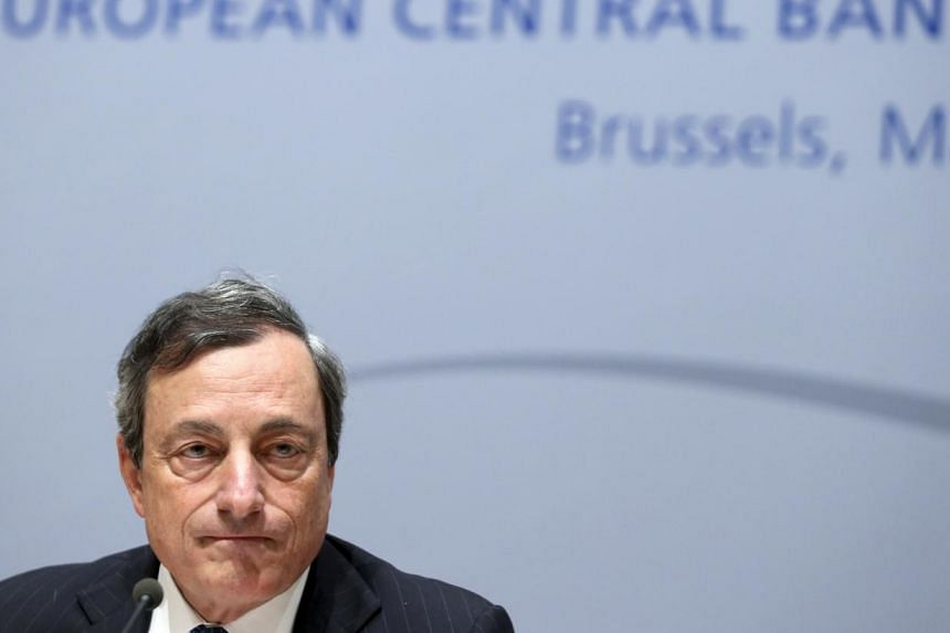 European Central Bank (ECB) president Mario Draghi addresses a news conference following the ECB Governing Council meeting in Brussels on May 8, 2014. The ECB on Thursday entered into uncharted territory in its battle against deflation, taking o