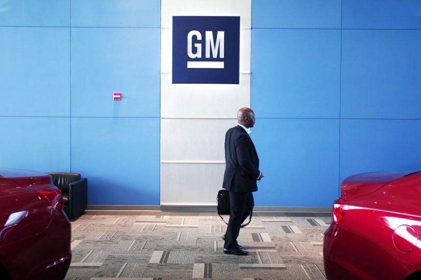 A person walks past the GM logo at the General Motors Technical Center as General Motors Chief Executive Officer Mary Barra holds a press conference on June 5, 2014 in Warren, Michigan. General Motors chief executive Mary Barra said that the com