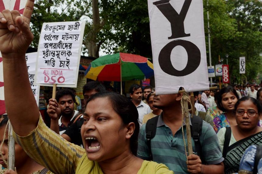 Indian activists from the Social Unity Center of India (SUCI) shout slogans against the state government during a protest against the alleged rape of a schoolgirl by three teenage boys in Kolkata on June 2, 2014.A lawmaker from Indian Prime Min