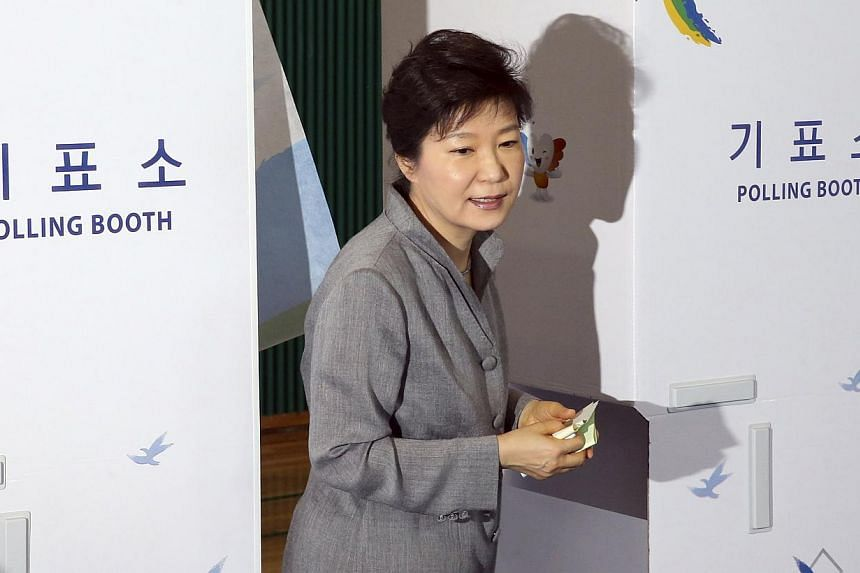 South Korean President Park Geun Hye walks out a voting booth after marking her ballots for the local elections at a polling station in Seoul on June 4, 2014. -- PHOTO: REUTERS