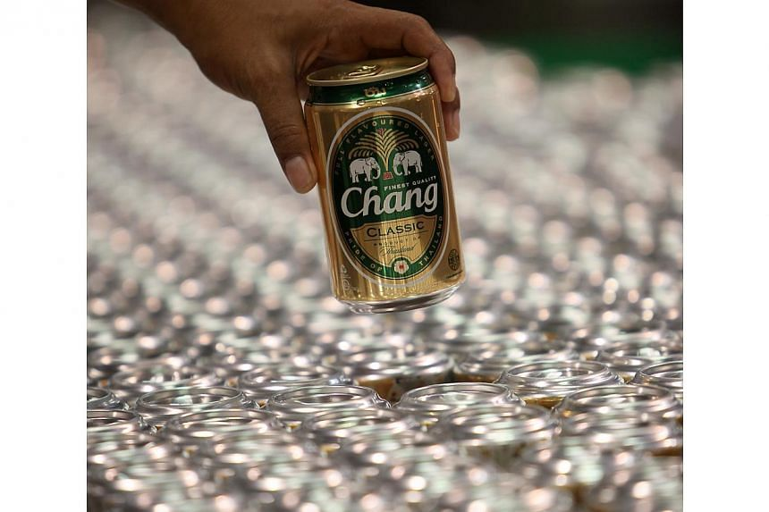 Thai Bev's defensive alcoholic portfolio will provide shelter against any economic contraction triggered by political uncertainty. -- PHOTO: BLOOMBERG
