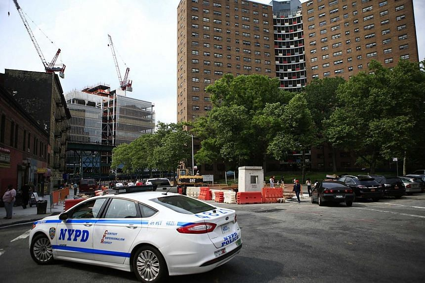 A NYPD car patrols the zone of Manhattanville houses in New York on June 4, 2014. -- PHOTO: REUTERS