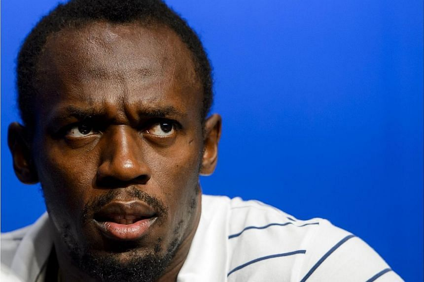 Jamaica's Usain Bolt looks on during a press conference following his visit at the FIFA headquarters in Zurich on August 28, 2013. Bolt, currently recovering from a foot injury, said on Friday, June 6, 2014, he is not ready to race at meets in O