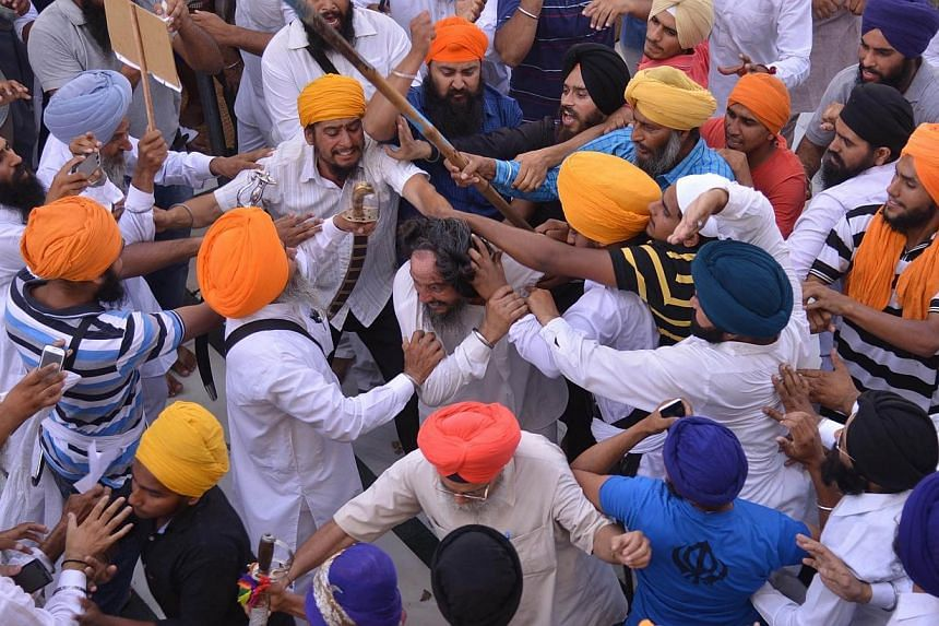 Sikh activists clash with members of the Shiromani Gurudwara Prabhandak Committee (SGPC) during commemorations for the 30th Anniversary of Operation Blue Star at the Golden Temple in Amritsar on June 6, 2014. -- PHOTO: AFP