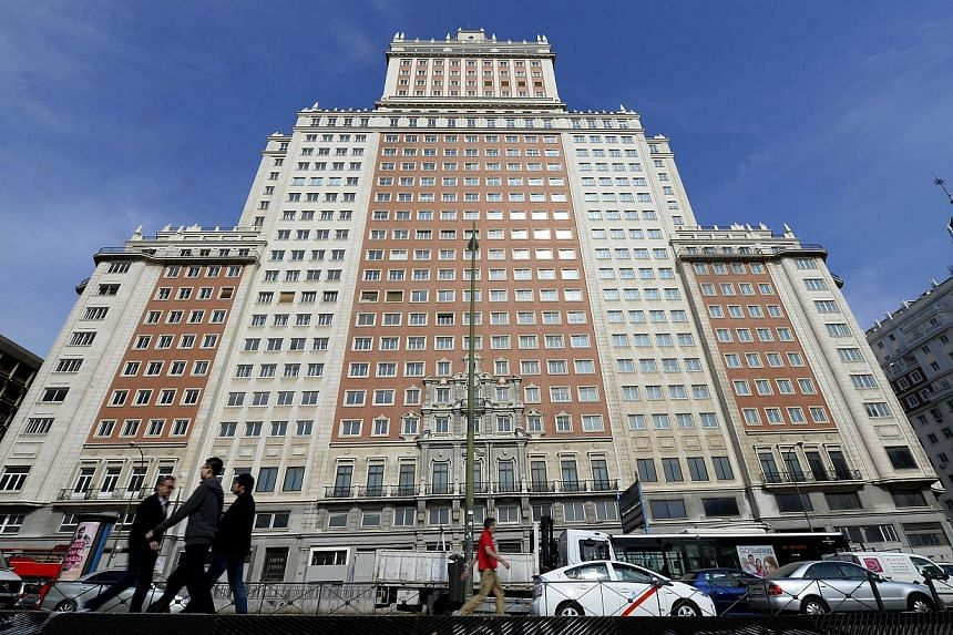 A file picture taken on March 19, 2014 shows the Edificio Espana building on the Plaza de Espana square in Madrid. China's richest man Wang Jianlin bought on June 5, 2014 the historic Madrid skyscraper for 265 million euros, Santander bank announced.