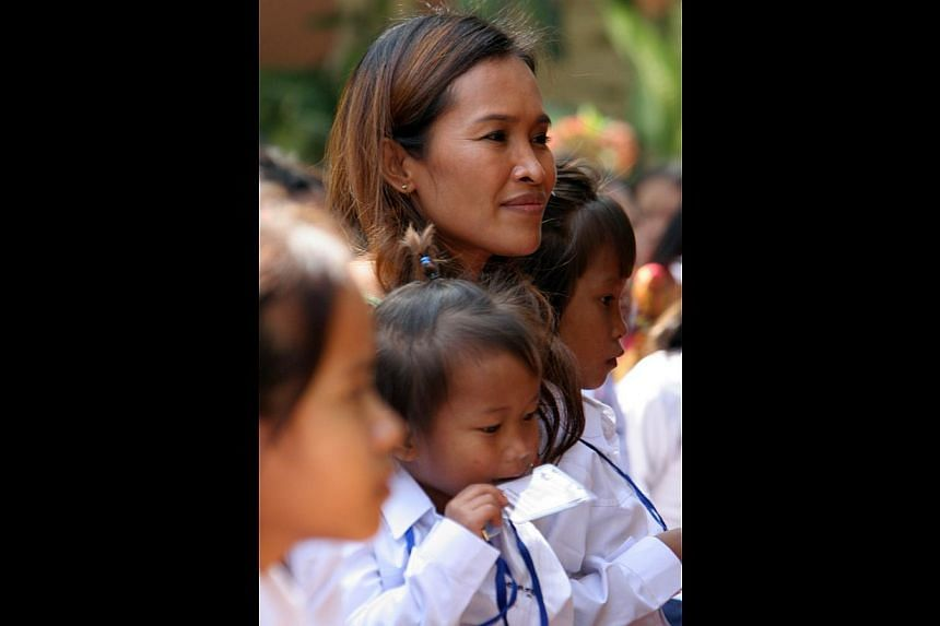 Ms Mam with Cambodian children at a vocational training centre in Phnom Penh in 2008. Her fans have now learnt she had fabricated much of the story used to raise millions of dollars over a decade or so.