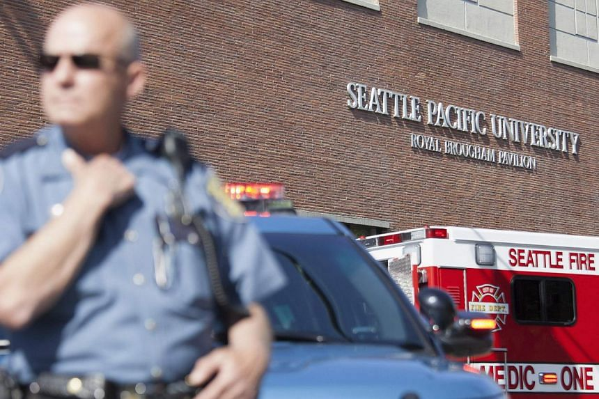 A policeman stands guard at Seattle Pacific University after the campus was evacuated due to a shooting in Seattle, Washington on June 5, 2014. A gunman opened fire on Thursday on the campus of a small Christian college in Seattle, killing one person