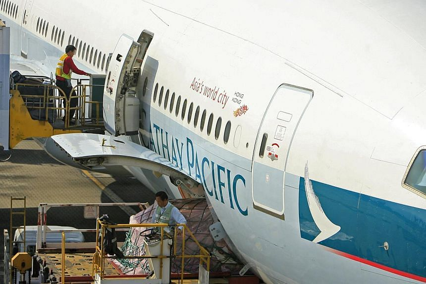 Air staff prepare a Cathay Pacific Airways Ltd. jet at Hong Kong International Airport in Hong Kong, China. The Hong Kong Airport Authority and two airlines said on Friday they had received a warning from Taiwan authorities regarding a possible bomb