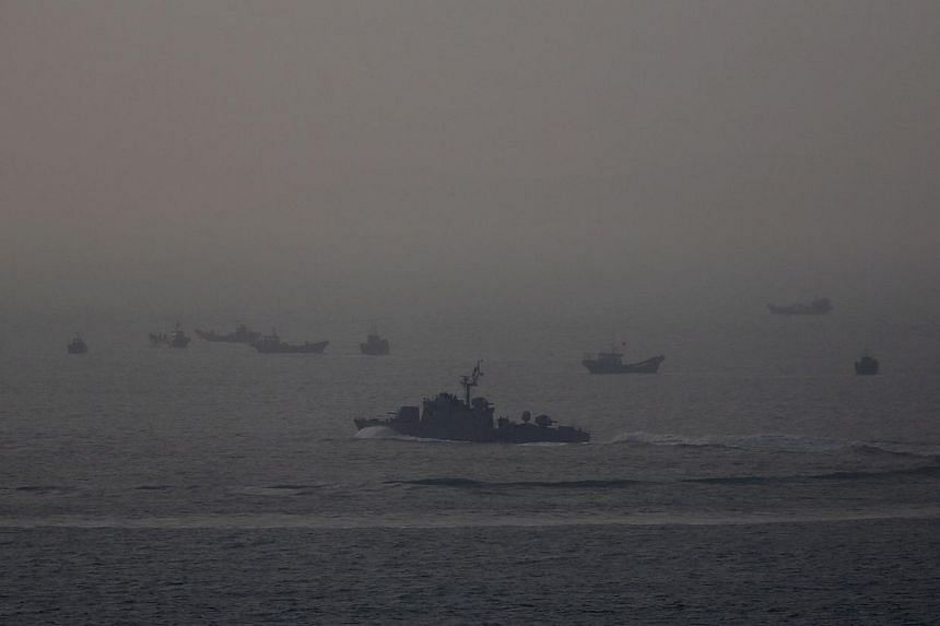 A South Korean corvette chasing away fishing boats sailing under Chinese flags after they came too close to the Northern Limit Line (NLL) just off the island of Yeonpyeong in the Yellow Sea April 8, 2014. -- FILE PHOTO: REUTERS