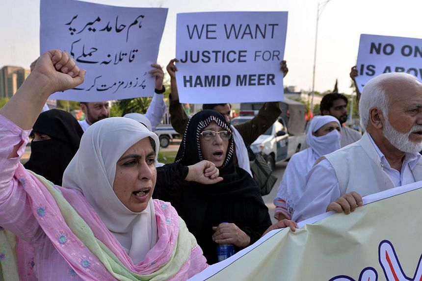 Pakistani activists from the Defence of Human Rights Pakistan organisation shout slogans during a protest against the attack on television journalist Hamid Mir by gunmen in Islamabad on April 22, 2014. A leading Pakistani journalist and TV anchor who