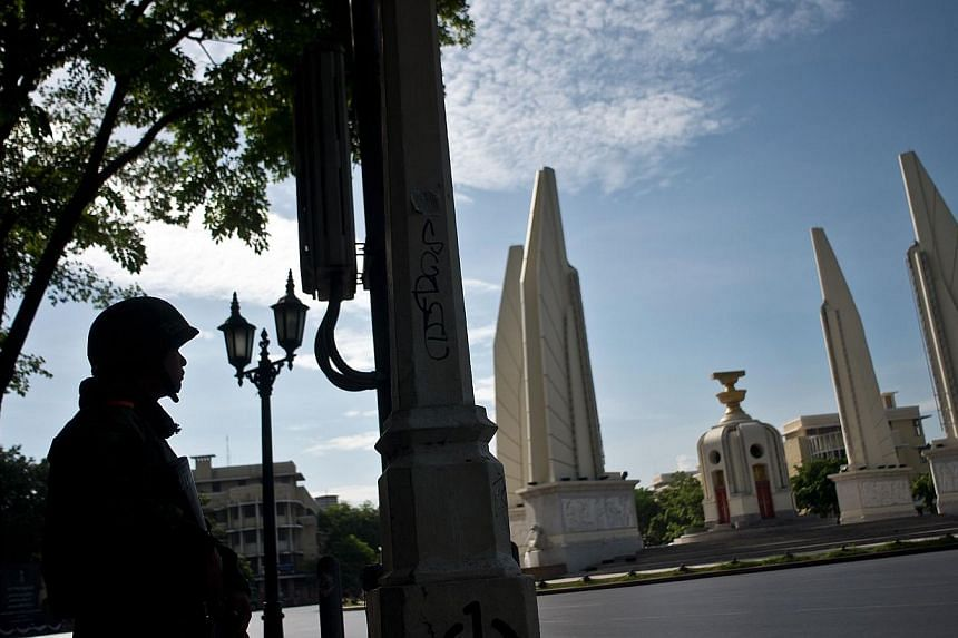A Thai Army soldier keeps guard at the Democracy monument, the site of months of anti-government protests after it was cleaned up in Bangkok on May 24, 2014. -- PHOTO: AFP
