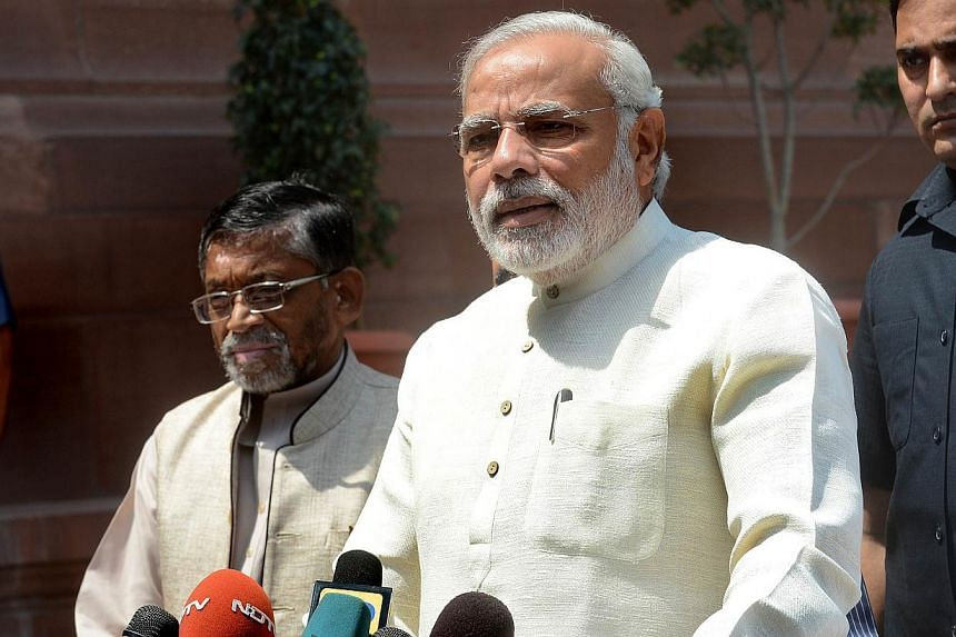 Indian Prime Minister Narendra Modi addressing the media on his arrival for the first session of India's newly elected Parliament in New Delhi on June 4, 2014. -- PHOTO: AFP