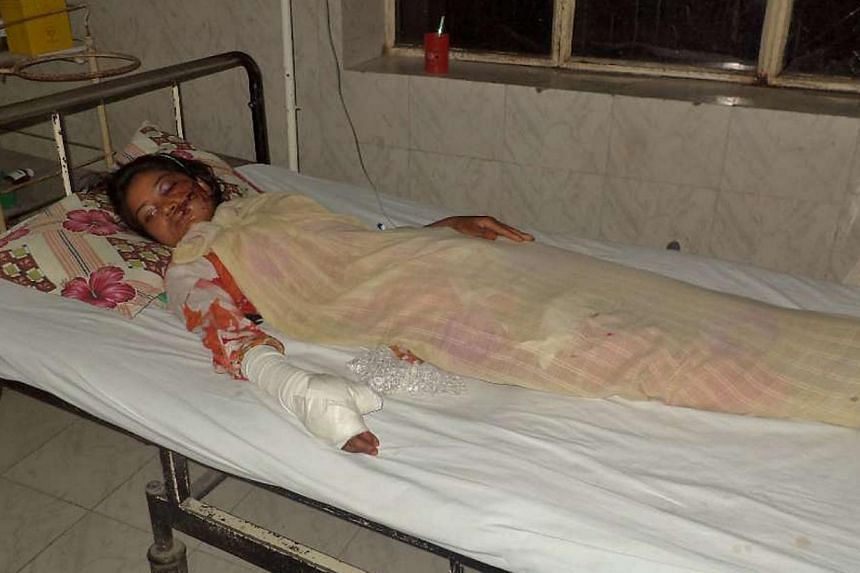 """Ms Saba Maqsood, 18, lying on a hospital bed in Hafizabad in Punjab Province on June 5, 2014. Ms Maqsood has survived being shot and thrown in a canal by her family for marrying the man she loved, the police said, weeks after the """"honour killing"""" of"""