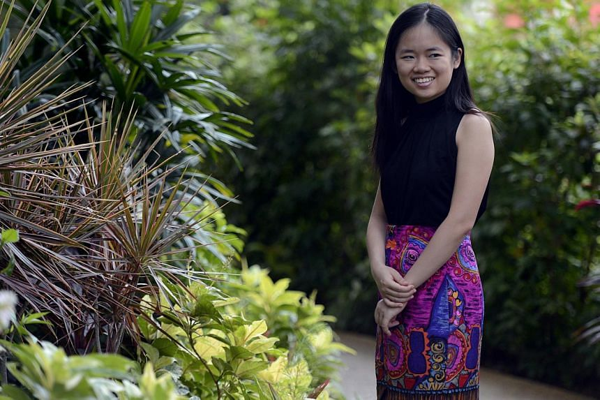Singapore piano prodigy Abigail Sin is on her way to pursuing a doctorate, with help from a prestigious scholarship.-- ST PHOTO:DESMOND FOO