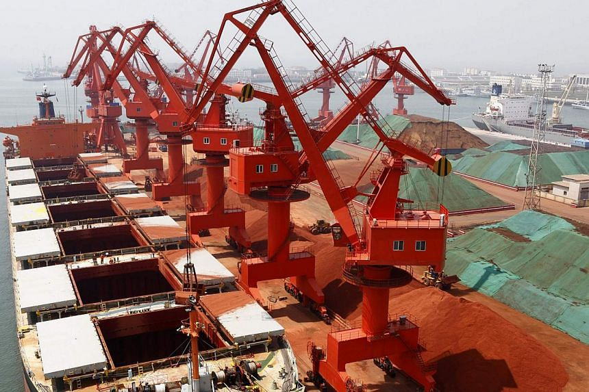 Metals are seen transported at Qingdao port, Shandong province. Shares in China's Qingdao Port International are set to open flat in their Hong Kong trading debut on Friday amid concern that the company could be hurt by a probe into metal financing a