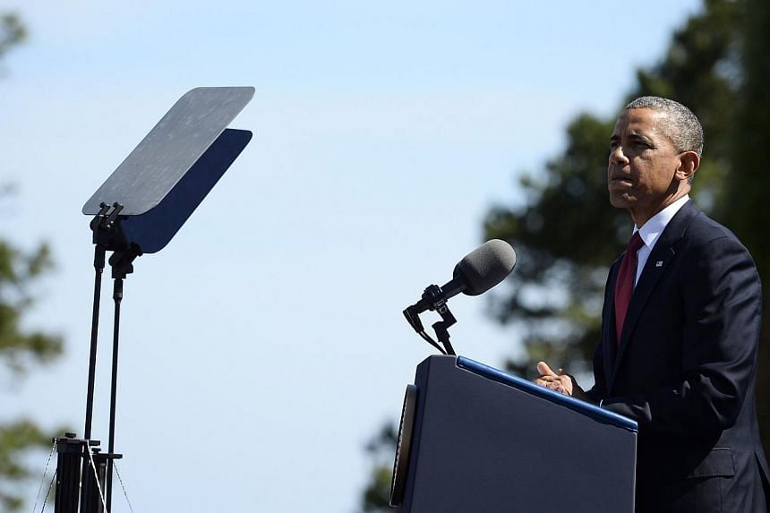 US President Barack Obama delivers a speech during a joint French-US D-Day commemoration ceremony at the Normandy American Cemetery and Memorial in Colleville-sur-mer, Normandy, on June 6, 2014, marking the 70th anniversary of the World War II Allied
