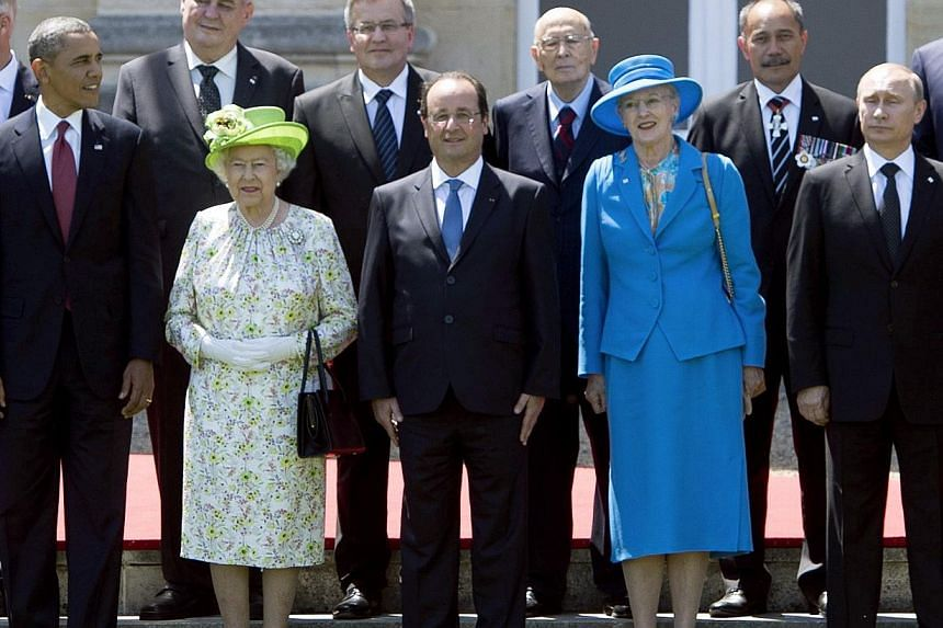 (From left) US President Barack Obama, Queen Elizabeth of Britain, French President Francois Hollande, Queen Margrethe of Denmark and Russian President Vladimir Putin participate in a group photo of world leaders attending the D-Day 70th Anniversary