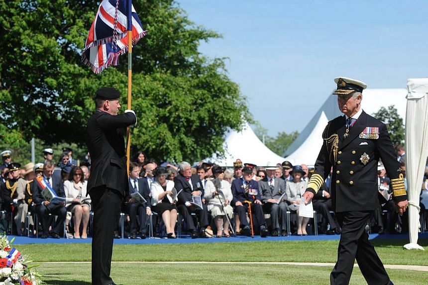 Britain's Prince Charles walks during a bi-national France-UK D-Day commemoration ceremony at the British War Cemetery of Bayeux, on June 6, 2014, marking the 70th anniversary of the World War II Allied landings in Normandy.-- PHOTO: AFP