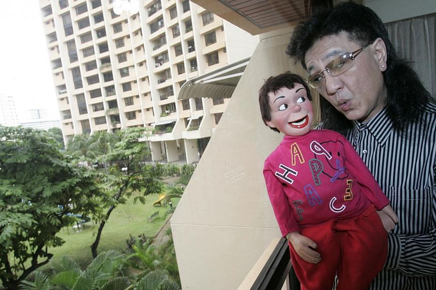 Victor Khoo and his ventriloqist dummy Charlee.Khoo died on Friday morning after a battle with cancer. -- PHOTO: ST FILE