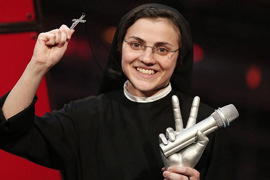 Sister Cristina Scuccia performing during the Italian State RAI TV program, The Voice of Italy, in Milan on June 5, 2014. -- PHOTO: AFP