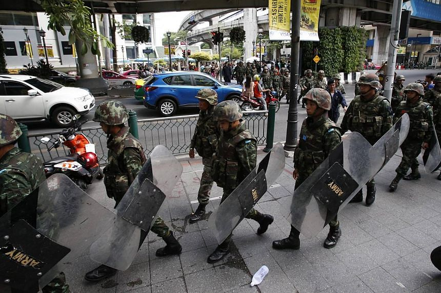 Soldiers take up positions to stop protests against military at a shopping district in Bangkok on June 1, 2014. -- PHOTO: REUTERS