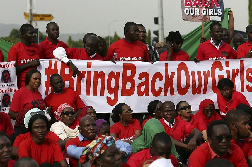 """The Abuja wing of the """"Bring Back Our Girls"""" protest group prepare to march to the presidential villa to deliver a protest letter to Nigeria's President Goodluck Jonathan in Abuja, calling for the release of the Nigerian schoolgirls in Chibok who wer"""