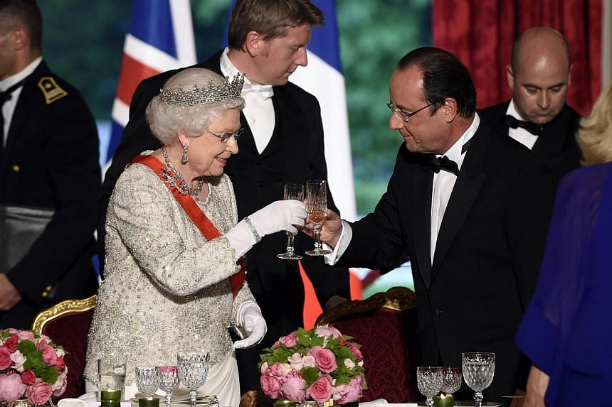 Britain's Queen Elizabeth II toasts with French President Francois Hollande at a state dinner at the Elysee presidential palace in Paris, following the international D-Day commemoration ceremonies in Normandy, marking the 70th anniversary of the Worl