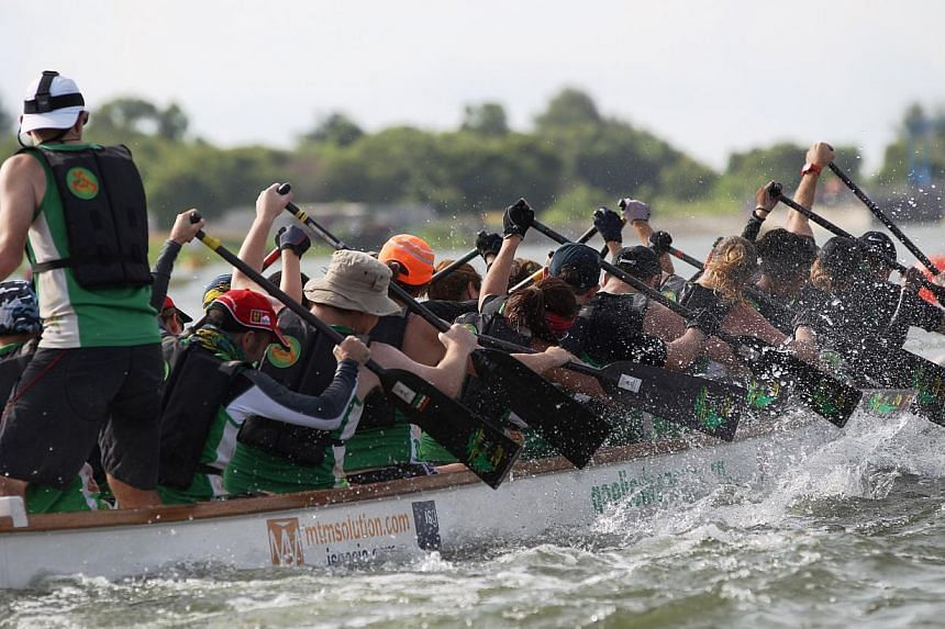 Dragon boat race participants in action at the Singapore International Water Festival.-- PHOTO:SINGAPORE POLYTECHNIC
