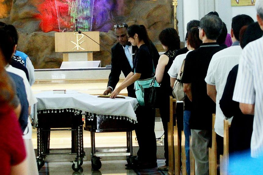 The double funeral service at the Church of Our Lady of Lourdes yesterday