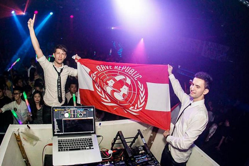 Clubgoers joining in a high-energy dance anthem as DJs unfurl the Rave Republic flag.--PHOTO: VINCENT CHAN