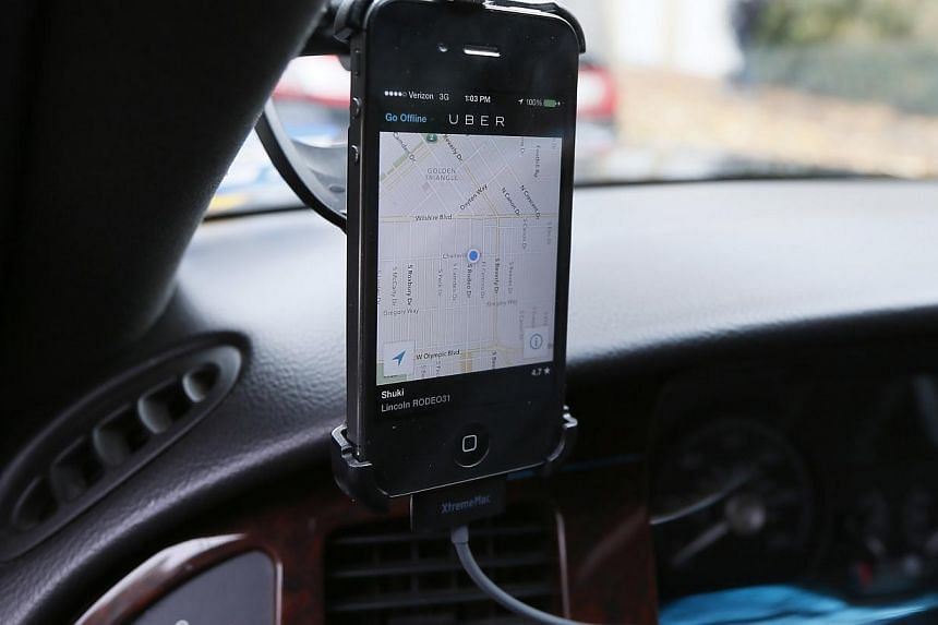 Transportation app Uber is seen on the iPhone of a limousine driver in Beverly Hills, California on Dec 19, 2013. -- PHOTO: REUTERS