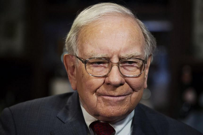 Investor Warren Buffett poses for a portrait during an interview after a luncheon to benefit the Glide Foundation of San Francisco in New York on April 23, 2014. -- PHOTO: REUTERS