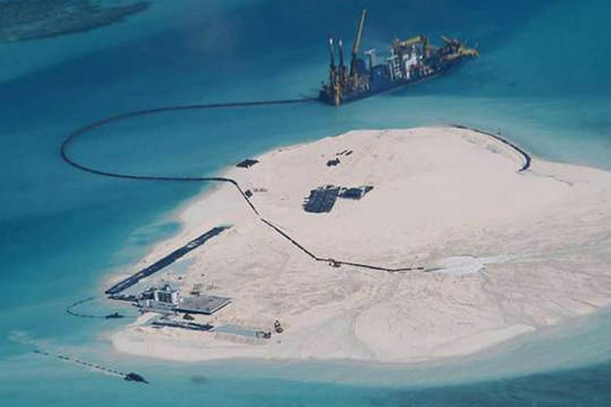 This undated handout photo released by the Department of Foreign Affairs (DFA) shows the alleged reclamation by China on what is internationally recognised as the Johnson South Reef in the South China Sea, otherwise known as the Mabini Reef by the Ph