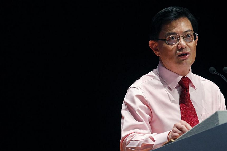 """Thousands of foreign fighters from some 50 countries have gone to Syria to fight against President Bashar al-Assad's regime, and Singaporeans are """"not immune to the call to fight"""", said Education Minister Heng Swee Keat on Saturday. -- ST PHOTO: TED"""