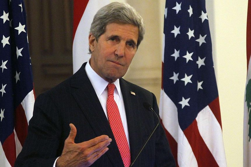 US Secretary of State John Kerry (above) gestures as he speaks during a news conference after meeting with Lebanon's Prime Minister Tammam Salam at the government palace in Beirut on June 4, 2014. -- PHOTO: REUTERS