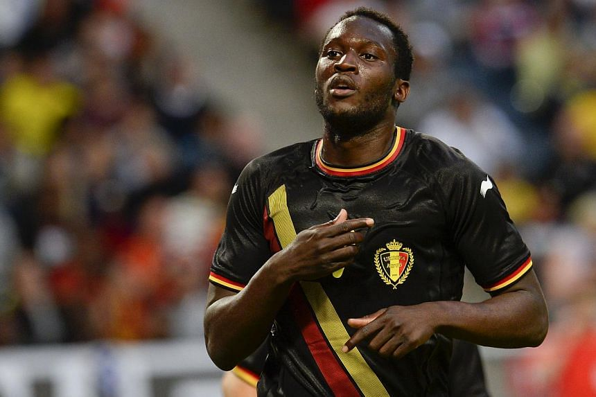 Romelo Lukaku celebrates after scoring a goal during the friendly football match between Sweden and Belgium at Friends Arena in Solna, near Stockholm on June 1, 2014. -- PHOTO: AFP