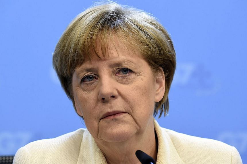 """Germany's Chancellor Angela Merkel holds a press conference on the last day of the G7 summit at the European Council headquarters on June 5, 2014, in Brussels.Balkan countries have a """"clear prospect"""" of joining the European Union, but the proce"""