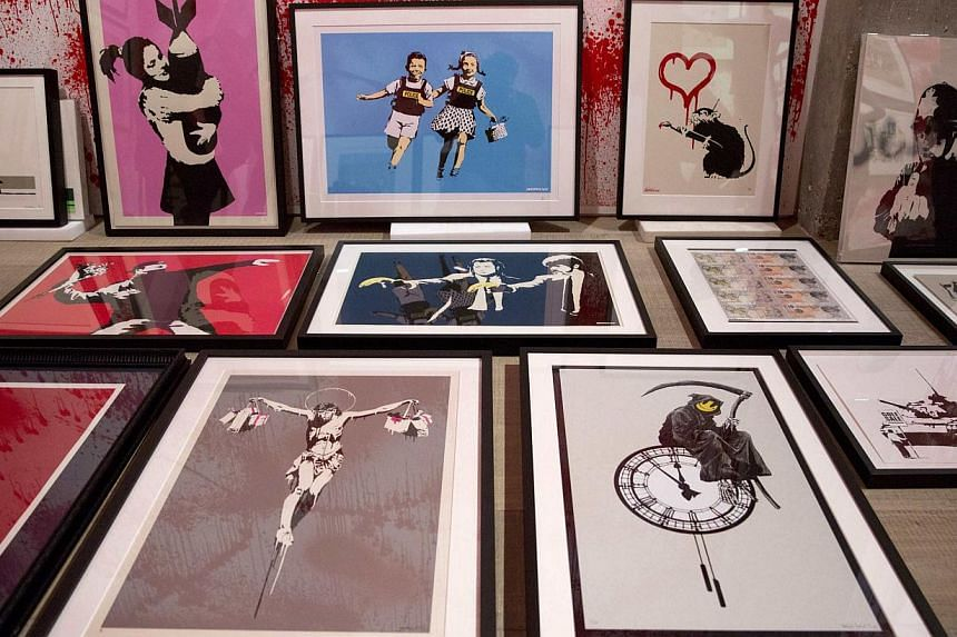 Art pieces wait to be hung at the Banksy: The Unauthorised Retrospective exhibition at Sotheby's S2 Gallery in London on June 6, 2014. -- PHOTO: REUTERS