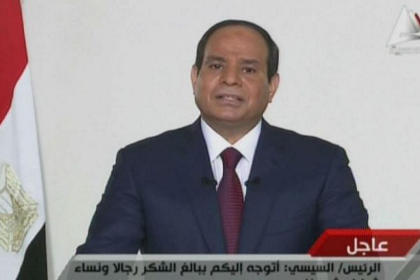 An image grab taken from Egyptian state TV shows ex-army chief and newly elected Egyptian President Abdel Fattah al-Sisi speaking in a televised address to his nation on June 3, 2014, after the electoral commission announced he won 96.9 percent of vo