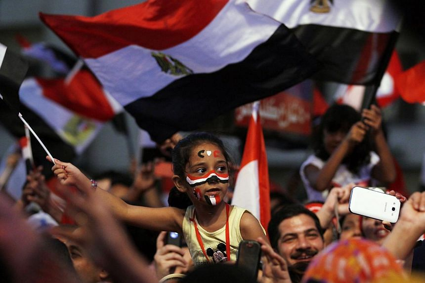 Egyptians gather outside the presidential palace to celebrate former Egyptian army chief Abdel Fattah al-Sisi's victory in the presidential vote in Cairo on June 5, 2014. -- PHOTO: REUTERS
