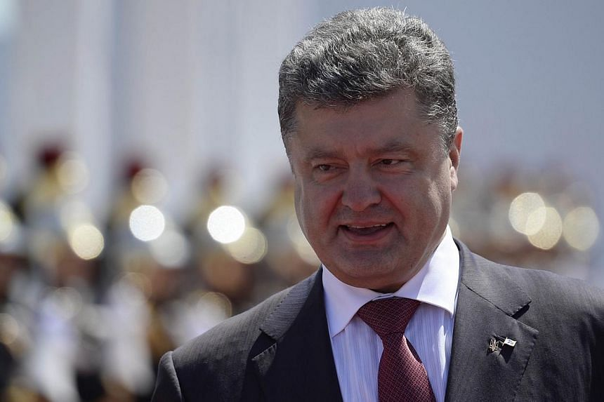 Mr Poroshenko was sworn in as president of his troubled country on Saturday as government forces battled pro-Russian separatists in the east. -- PHOTO: AFP