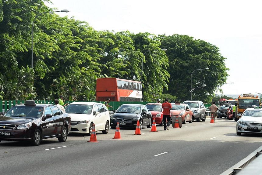 The accident occurred at about 2.30pm on the PIE towards Changi Airport, above the Paya Lebar flyover.-- ST PHOTO:AZIZ HUSSIN